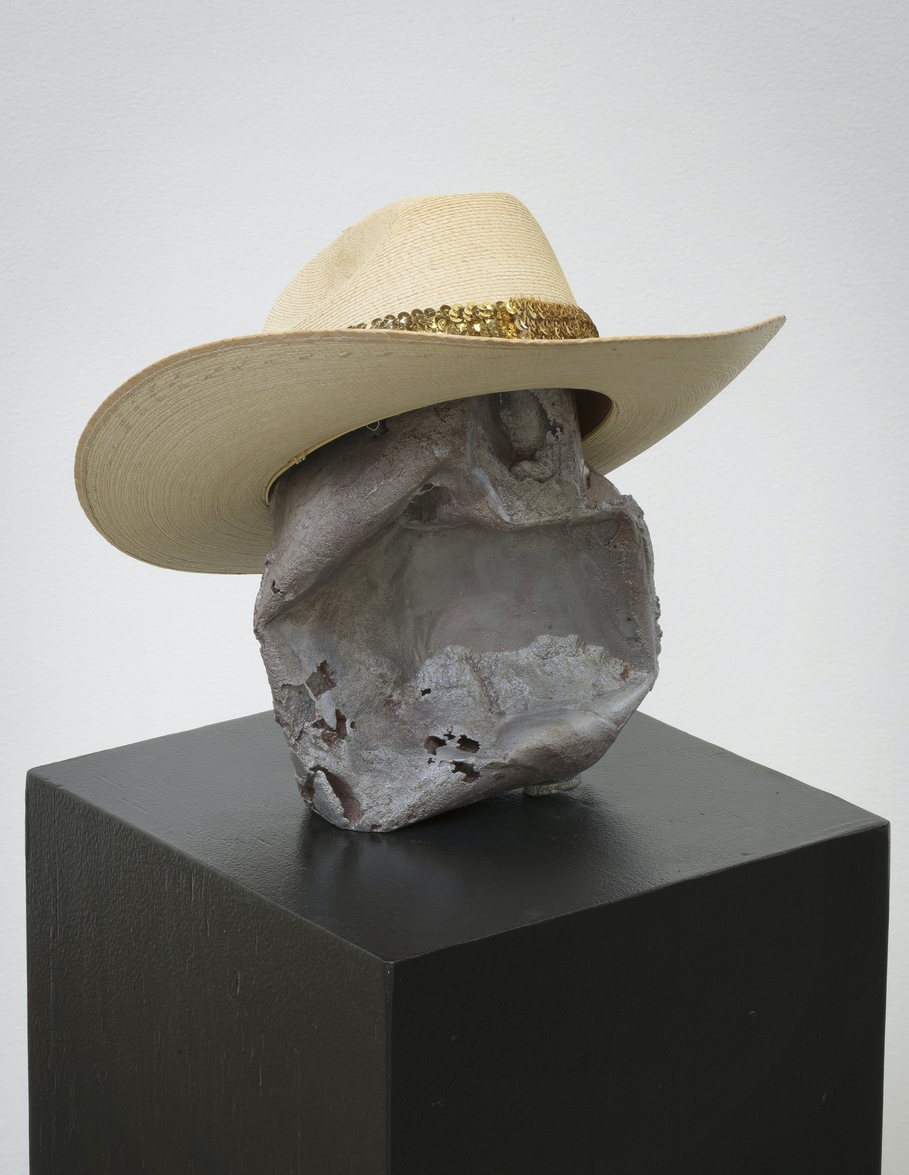 "Edgar Arceneaux ""Red Ronnie,"" 2017 Cast aluminum, enamel, hat, pedestal 48.75 x 12.5 x 12.75"" [HxWxD] (123.83 x 31.75 x 32.39 cm) Inventory #ARC564 Courtesy of the artist and Vielmetter Los Angeles Photo credit: Robert Wedemeyer"