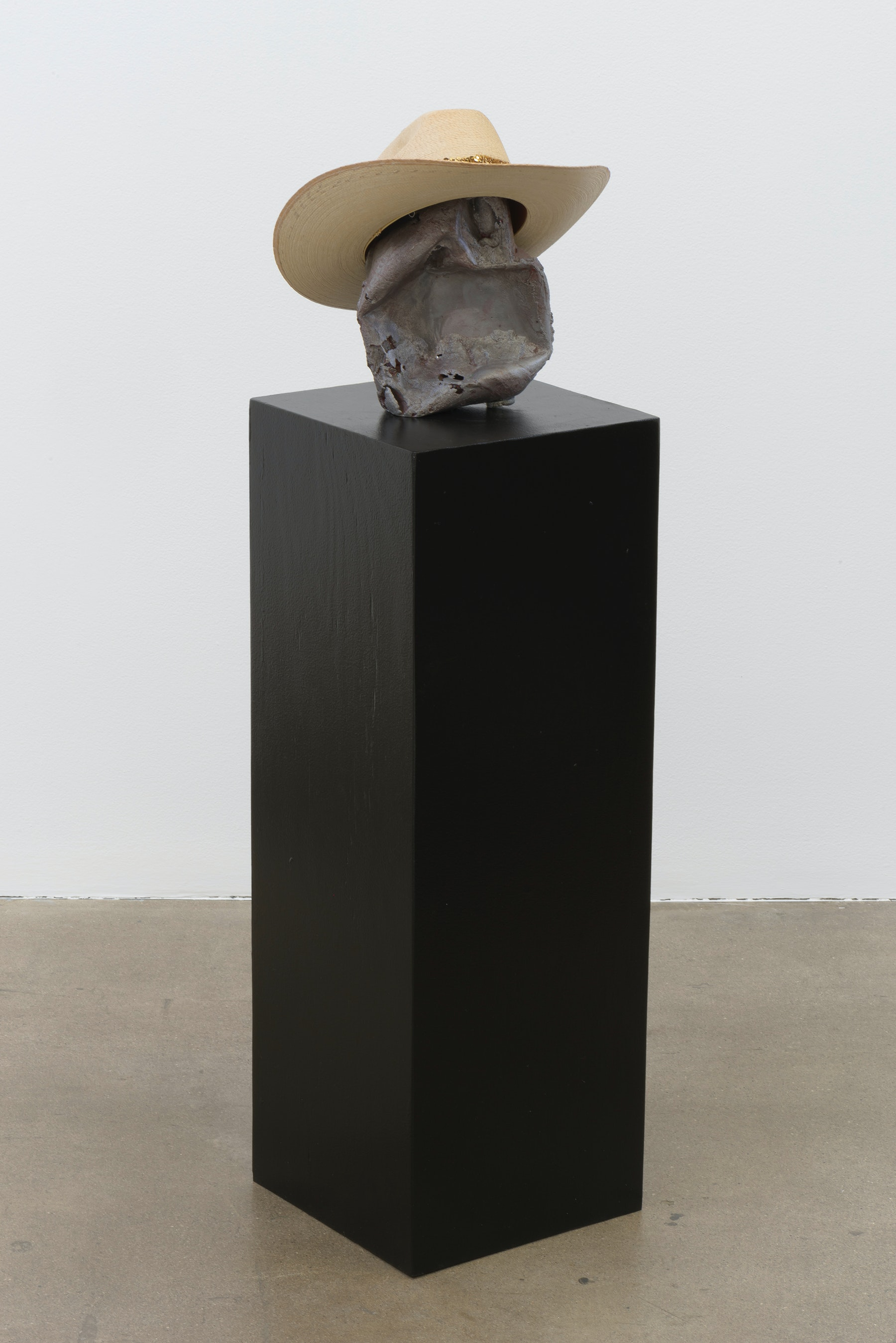 "Edgar Arceneaux ""Red Ronnie,"" 2017 Cast aluminum, enamel, hat, pedestal 48.75 x 12.5 x 12.75"" [HxWxD] (123.83 x 31.75 x 32.39 cm) Inventory #ARC564 Courtesy of the artist and Vielmetter Los Angeles Photo credit: Robert Wedemeyer"