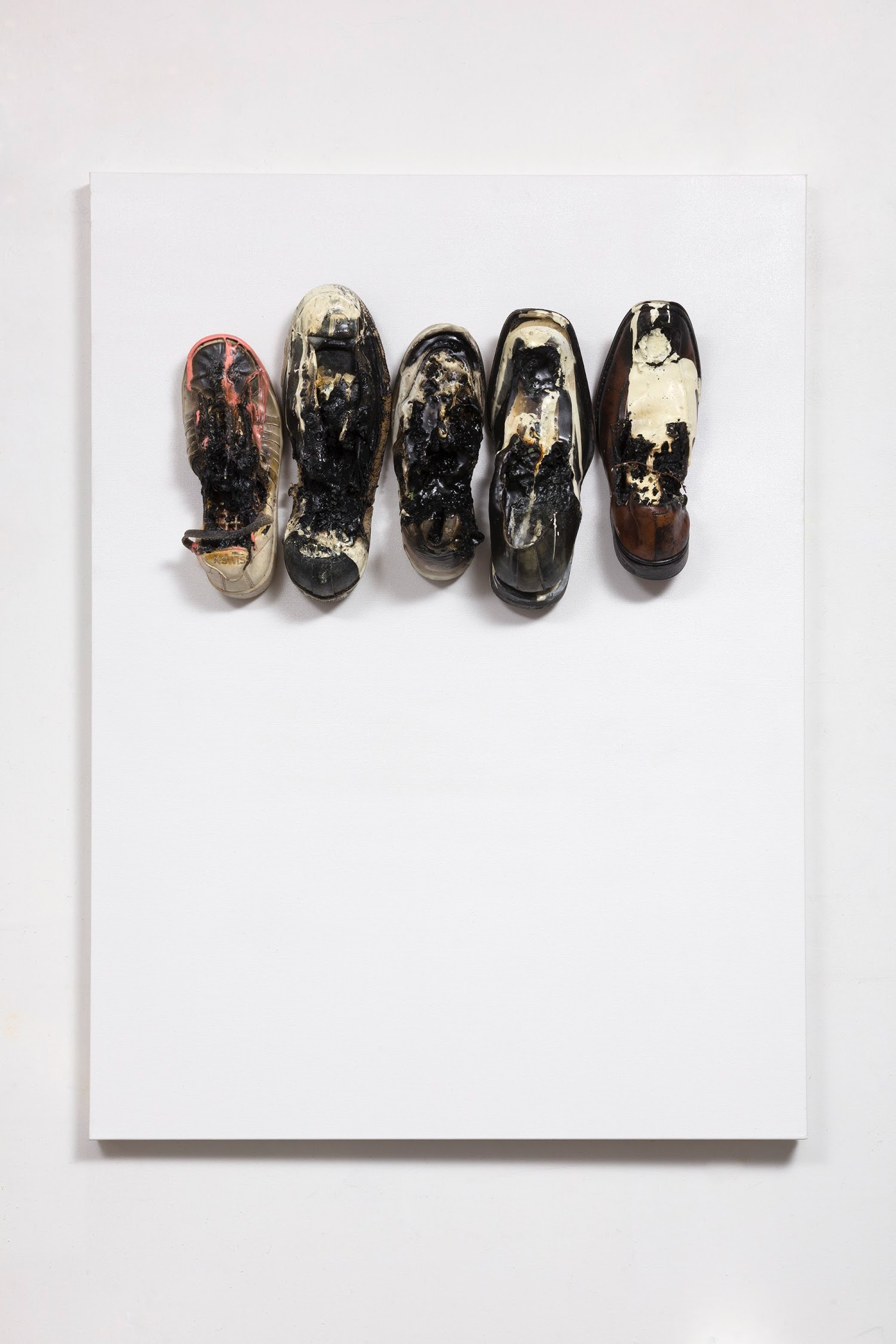 """Edgar Arceneaux """"In Between The Steps, #1,"""" 2020 Shoes, grass, weeds, sticks, acrylic paint, oil paint and resin on canvas 40 x 30 x 7"""" [HxWxD] (101.6 x 76.2 x 17.78 cm) Inventory #ARC620 Courtesy of the artist and Vielmetter Los Angeles"""