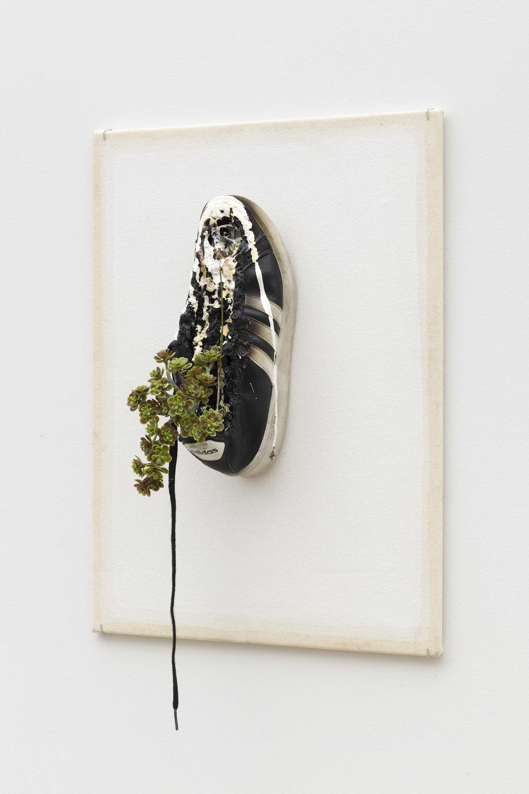 """Edgar Arceneaux """"Gaps Between the Steps II,"""" 2020 Shoe, acrylic paint, sticks, leaves and grass, resin on canvas 23 x 16 x 6"""" [HxWxD] (58.42 x 40.64 x 15.24 cm) Inventory #ARC622 Courtesy of the artist and Vielmetter Los Angeles Photo credit: Jeff Mclane"""
