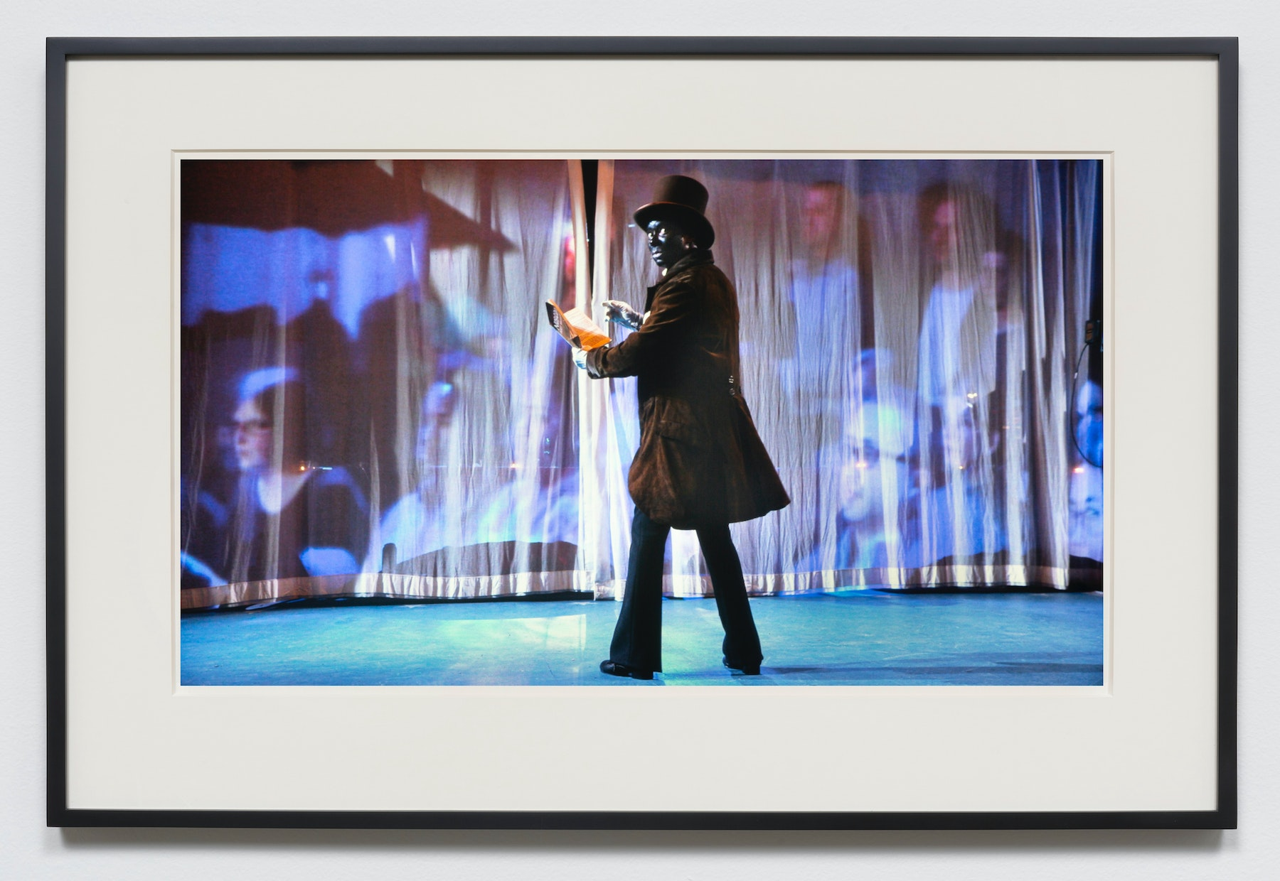 """Edgar Arceneaux """"Lemme See Here,"""" 2015-2020 Photographic print 20 x 36"""" [HxW] (50.8 x 91.44 cm) unframed, 23.5 x 39.5 x 2"""" [HxWxD] (59.69 x 100.33 x 5.08 cm) framed Edition 1 of 5, 2 AP Inventory #ARC630.01 Courtesy of the artist and Vielmetter Los Angeles"""