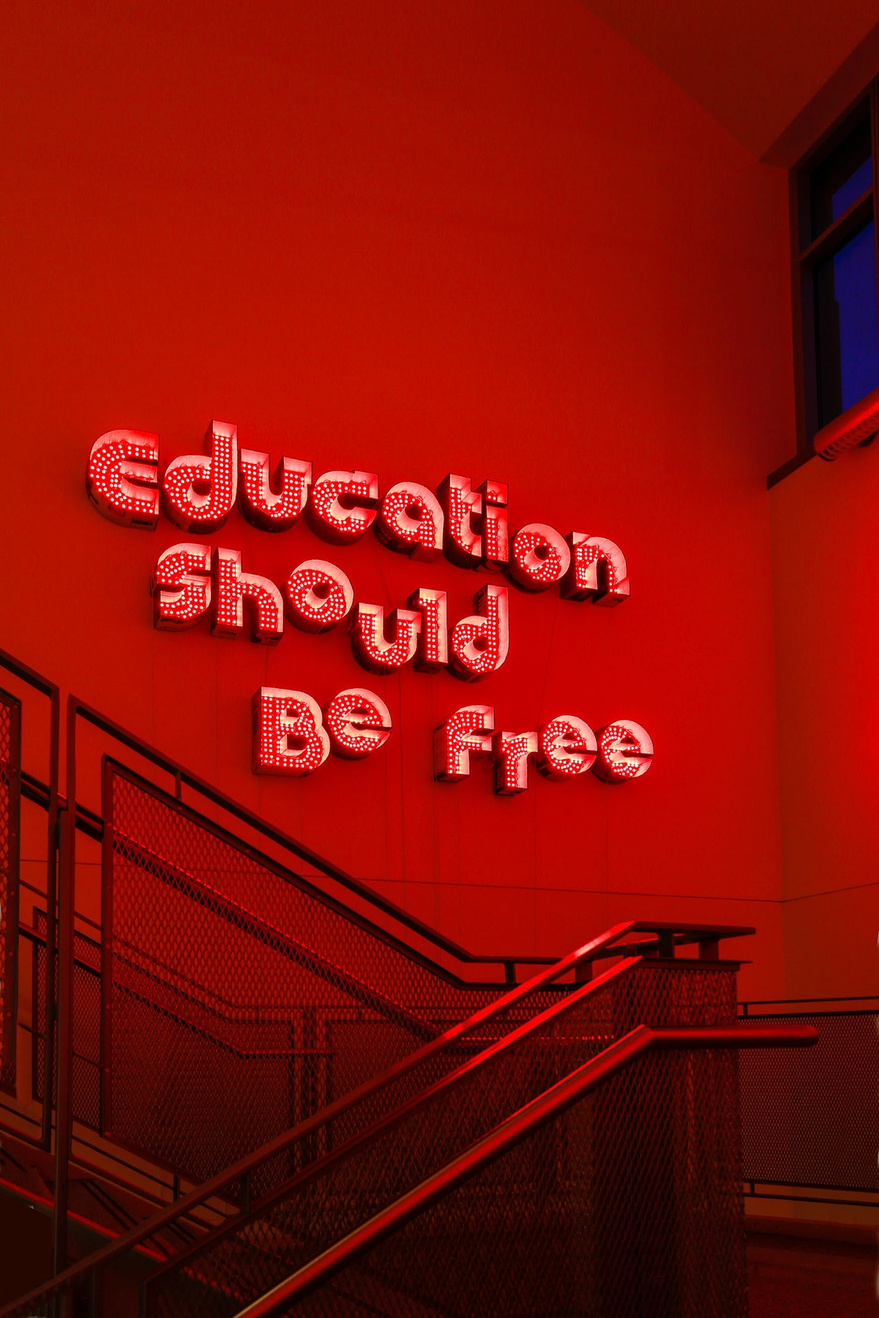 "Andrea Bowers ""Education Should be Free,"" 2016 Cardboard and color changing LED lights 65.7 x 107"" [HxW] (166.88 x 271.78 cm) Inventory #BOW454 Courtesy of the artist and Vielmetter Los Angeles Photo credit: Mark Woods"