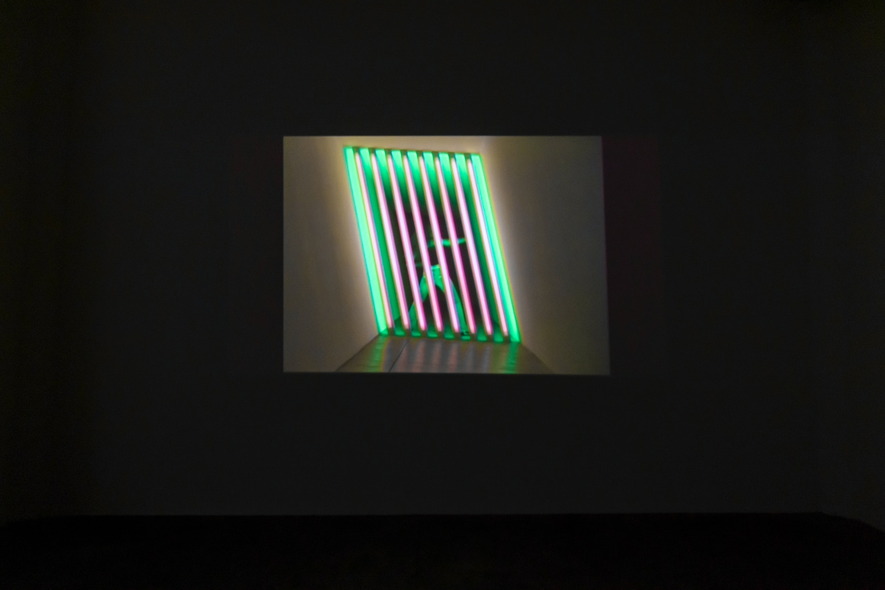 """Andrea Bowers """"Avenging the Ghosts of My Younger Self (Situated Between Minimalist Art and Arcade Games),"""" 2002, (remastered 2021) Single channel video projection (silent, 2:53 min. looped) Dimensions variable Inventory #BOW596 Courtesy of the artist and Vielmetter Los Angeles"""