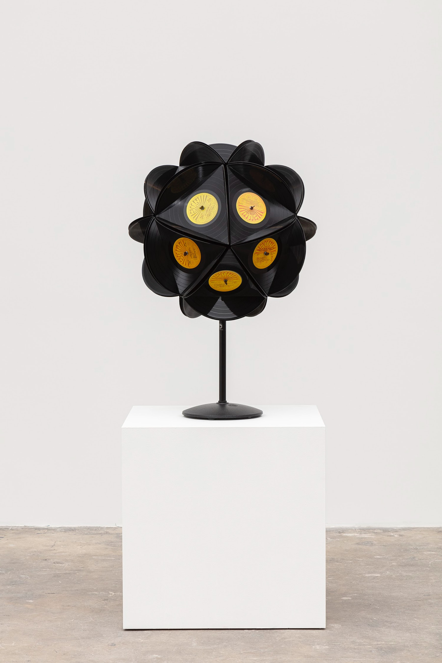 """Sean Duffy """"Star Seed,"""" 2021 20 Sun records, microphone stand, wood, enamel and metal hardware 34"""" x 21"""" x 21"""" [HxWxD] (86.36 x 53.34 x 53.34 cm) Inventory #DUF357 Courtesy of the artist and Vielmetter Los Angeles Photo credit: Evan Bedford"""