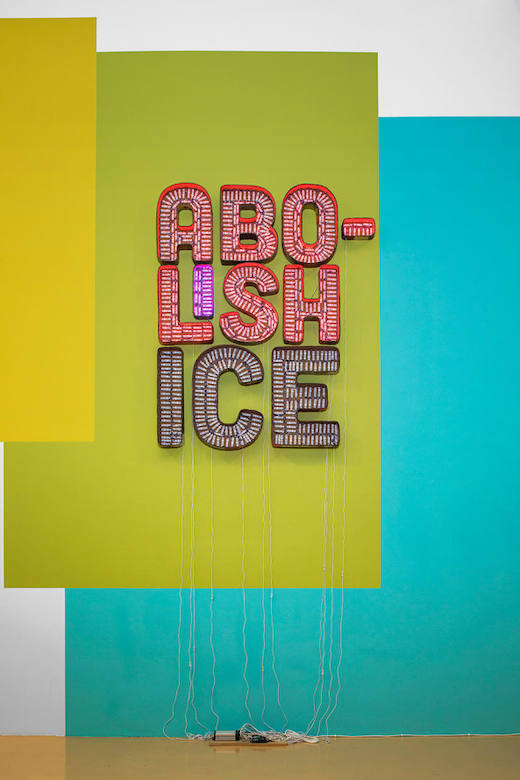 This is an artwork titled Abolish ICE by artist Andrea Bowers made in 2018