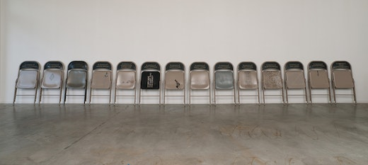 This is an artwork titled Chair # 1 - 14 by artist Andrea Bowers made in 2010
