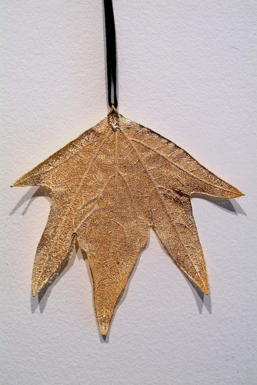 This is an artwork titled Golden Leaf Pendants by artist Joel Tauber made in 2007
