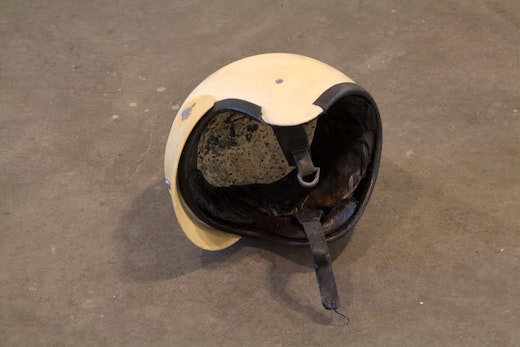 This is an artwork titled First Helmet by artist Sean Duffy made in 2006