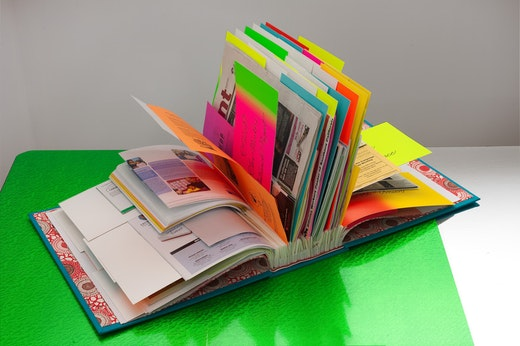 """This is an artwork titled Book from """"Workers' Rights Table"""" Installation by artist Andrea Bowers made in 2012"""