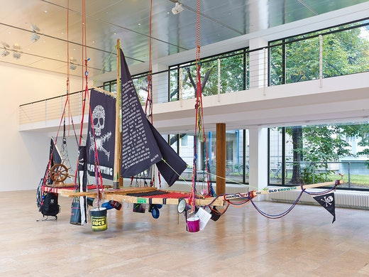 """This is an artwork titled """"Radical Feminist Pirate Ship Tree Sitting Platform"""" by artist Andrea Bowers made in 2013"""