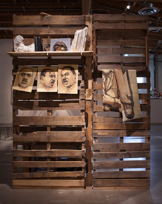 This is an artwork titled A Book and a Medal: Disentanglement Equals Homogenous Abstractions by artist Edgar Arceneaux made in 2014