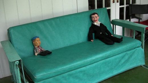 This is an artwork titled Dummies on a Porch Swing (Lee Atwater Interview, 1981) by artist Rodney McMillian made in 2012