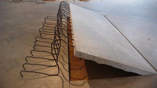 "Ruben Ochoa ""It's what I thought,"" 2009 Concrete slab, rebar, dirt 26"" high x 132"" wide 90"" long"
