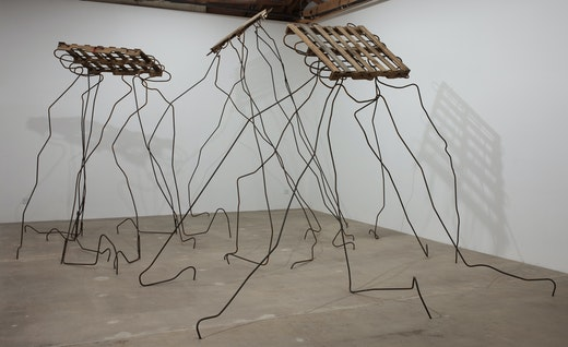 "Ruben Ochoa ""At First Blush,"" 2010 Pallets and rebar Approximately 13'H x 18'W x 18'D"