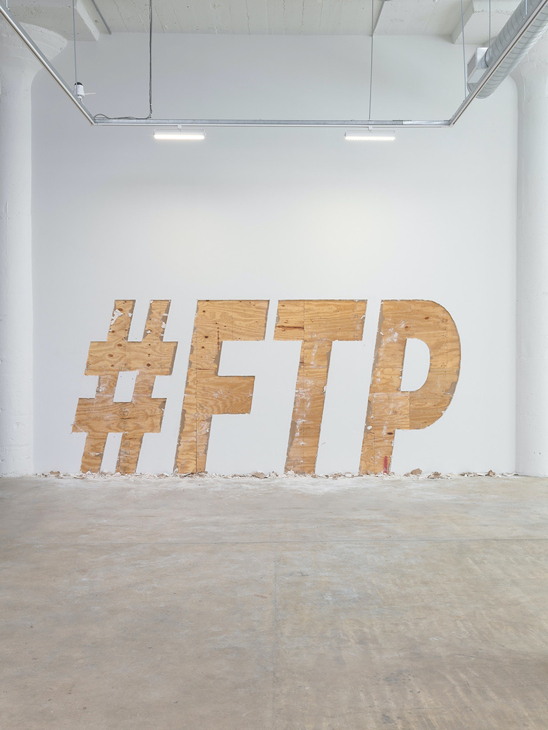 """Ruben Ochoa """"If I Had A Hashtag for Every Time Someone Tried To Hold Me Down,"""" 2020 79 x 216"""" [HxW] (200.66 x 548.64 cm) Edition 1 of 5, 2 AP Inventory #OCH367.01 Courtesy of the artist and Vielmetter Los Angeles Photo credit: Robert Wedemeyer"""
