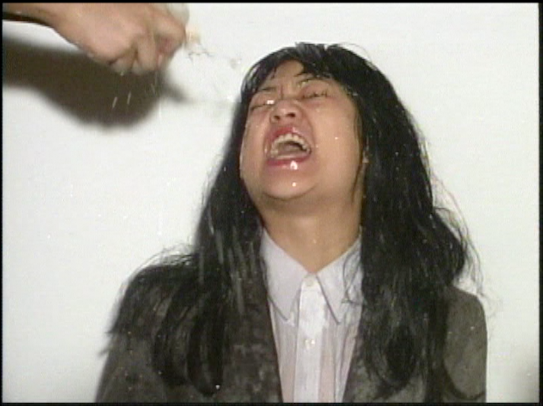 """Patty Chang """"Hand to Mouth,"""" 2000 Single channel DVD with sound 6 minutes Edition of 5"""