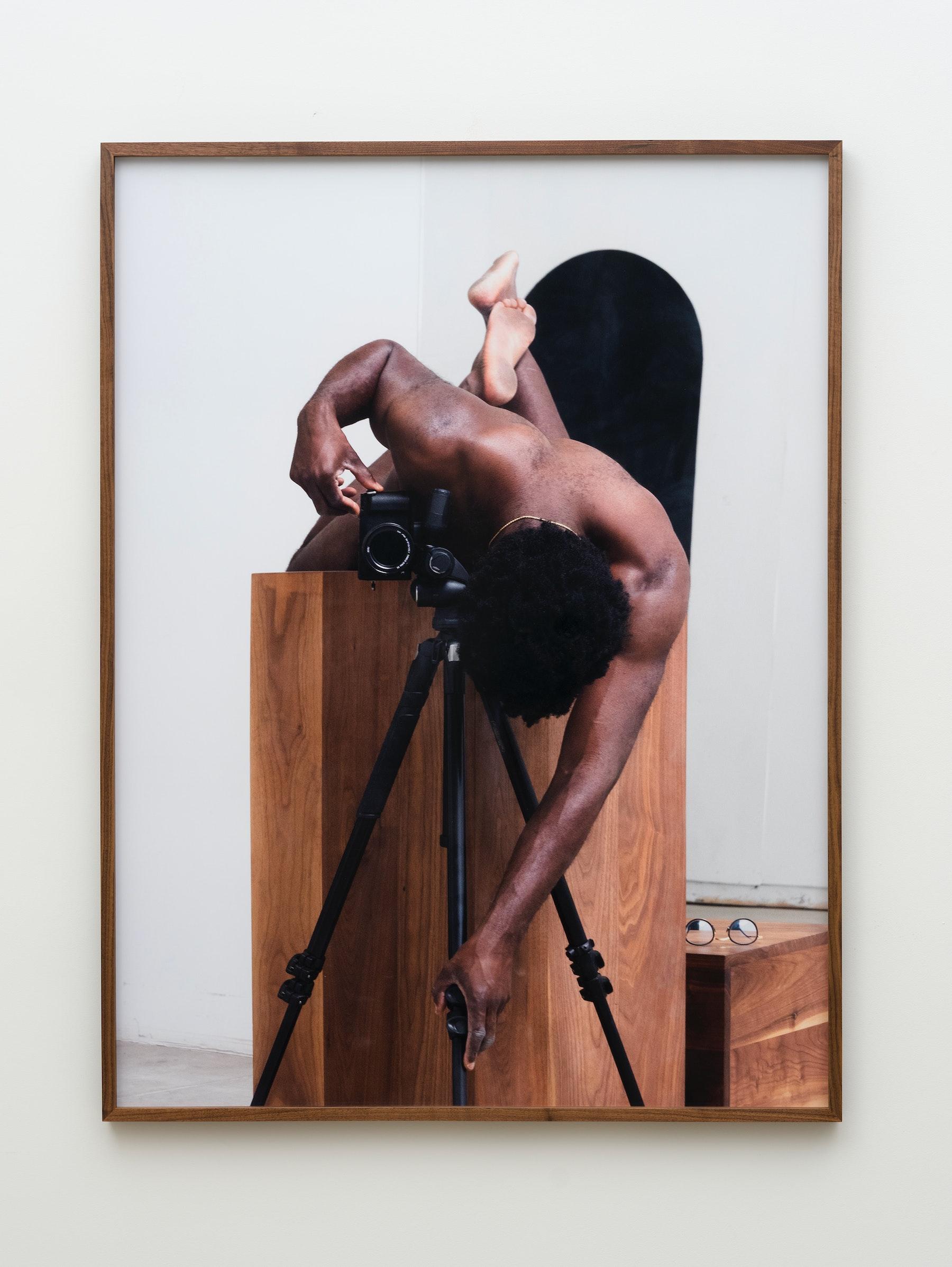 "Paul Mpagi Sepuya ""Pedestal (_1180277),"" 2021 Archival pigment print 53"" x 40"" [HxW] (134.62 x 101.6 cm) print size; 54 ¹⁄₂"" x 41"" x 2"" [HxWxD] (138.43 x 104.14 x 5.08 cm) framed Edition 1 of 5, 2 AP Inventory #SEP721.01 Courtesy of the artist and Vielmetter Los Angeles Photo credit: Jeff McLane"